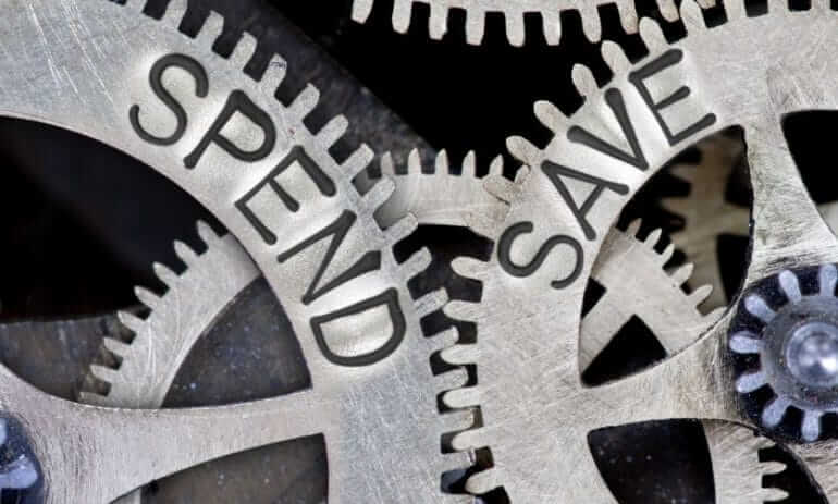 Gears with 'spend' and 'save' written on them